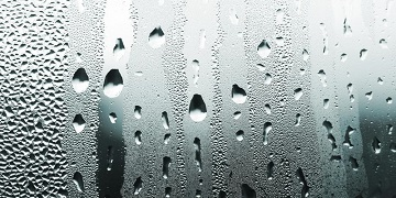 Droplets Of Condensed Water On Glass